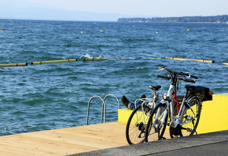 Two bicycles parked on the shore of geneva lake