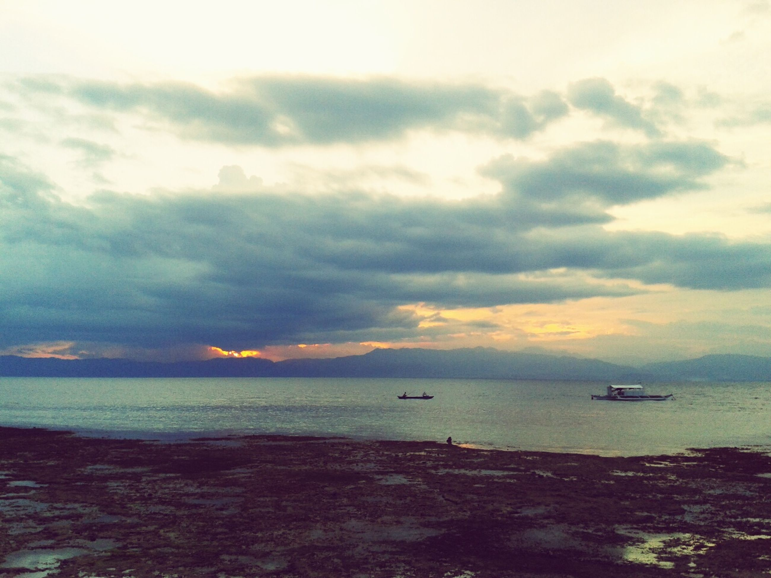 sea, horizon over water, water, sky, nautical vessel, transportation, scenics, boat, tranquil scene, mode of transport, tranquility, beauty in nature, sunset, cloud - sky, nature, beach, cloudy, idyllic, shore, cloud