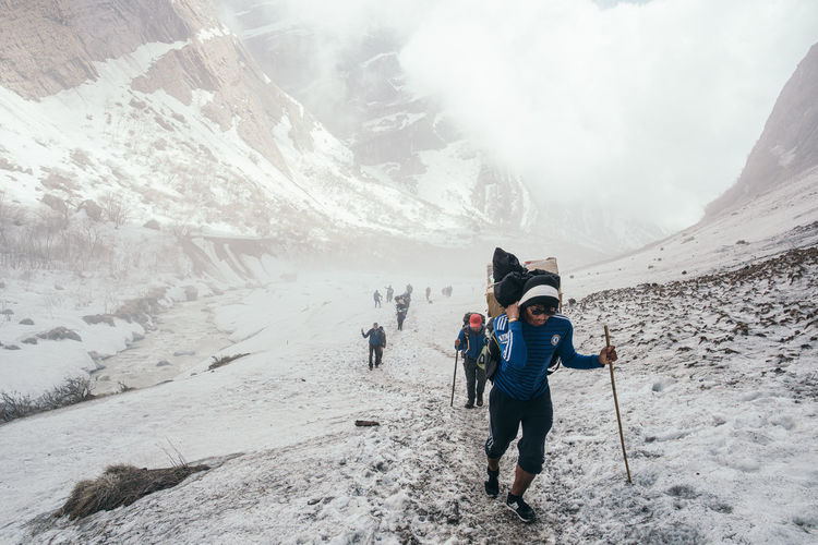 Life of a Porter The Photojournalist - 2019 EyeEm Awards The Great Outdoors - 2019 EyeEm Awards Hikers Trekker Valley View Wild Adventure Photography Travel Photography Travel Destinations Travel Life Journey Life Events Windy Nature Trail Scenics - Nature Journey Adventure Extreme Terrain Extreme Weather Valley Annapurna Range Himalayas Nepal Travel Nepal Hiking Adventures Hiking Trail Hikingadventures Trail Hiking Trekking Annapurna Base Camp Trek Annapurna Conservation Area Annapurna Porter Outdoors Nature People Mountain Leisure Activity Snow Lifestyles Cold Temperature Winter The Traveler - 2019 EyeEm Awards