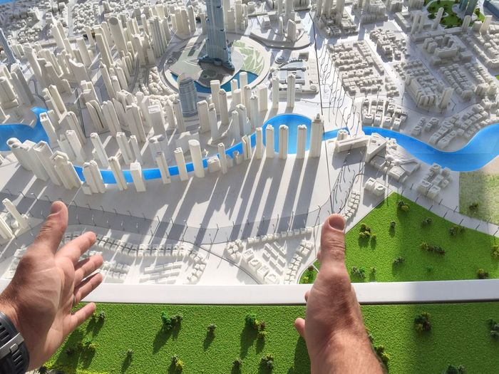 Miniature city plan of Dubai Inspirational Moment Vision Future City Miniture Model Developing City Development/construction Planning A City Architecture Model - Object City Model City Planning Dubaicity Dubai Human Body Part Human Hand Adult People Only Men Indoors  One Person