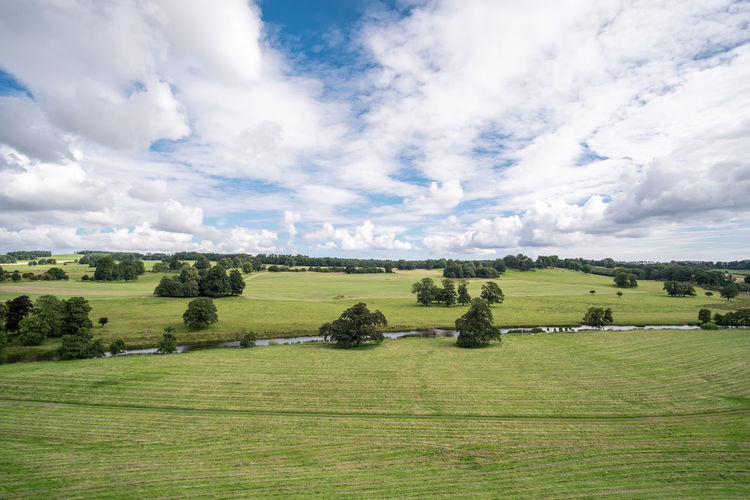View of green field with River Aln, taken from Alnwick Castle Agriculture Aln Alnmouth Alnwick Beautiful Blue Bridge Britain British Clouds Country Countryside Daytime East England English Europe European  Farmland Field Grass Grassland Green Landscape Meadow Mount Nature North Northern Northumberland Outdoor Outdoors Pleasant River Riverbank Riverside Rural