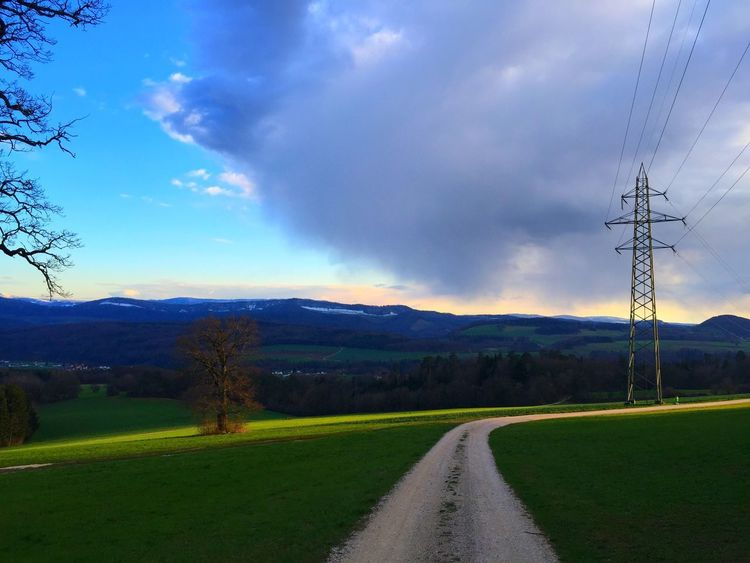 Beauty In Nature Cable Cloud - Sky Connection Day Electricity  Electricity Pylon Grass Landscape Mountain Nature No People Outdoors Road Scenics Sky Spring 2015 The Way Forward Tranquil Scene Tranquility Transportation Tree