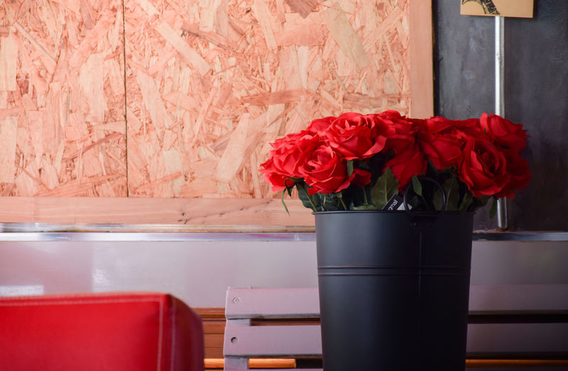 Close-up of red rose flower vase on table