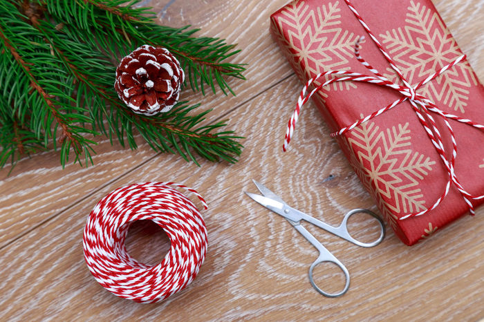Tradition Christmas Tree Spruce Preparation  Tree Branch Christmas Decoration Flat Lay Christmas Spirit Decor Rustic Style Gift Rope Wrap Ribbon Wooden Background Present Suprise Box Gift Box New Year MAS Xmas Christmas Rustic