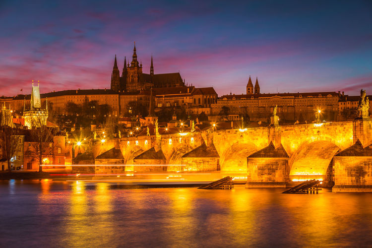 Architecture Building Exterior Built Structure City Cityscape Illuminated Night No People Outdoors Prague River Sky Sunset Travel Destinations Water Waterfront