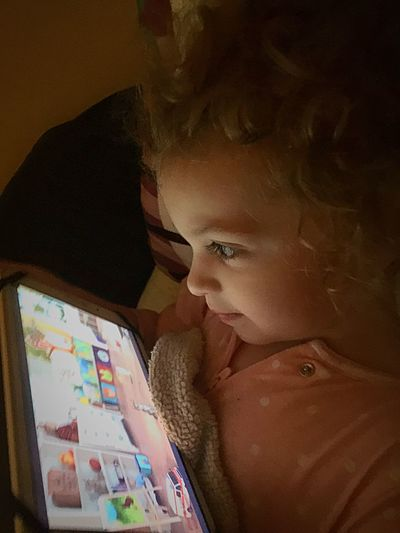 Technology Watching Toddler  Quiet Lifestyles Leisure Activity Childhood Real People Indoors  Touching Quiet Relaxation Playing Smart Close-up Learning Happy Advanced Sweet Cute