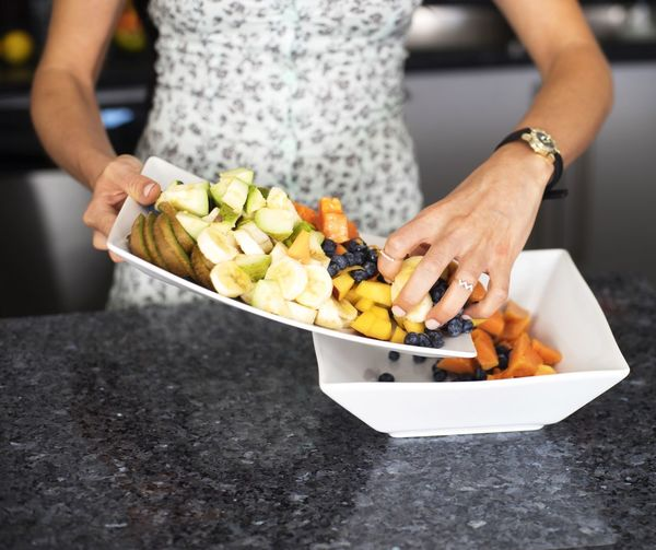 Cropped hand holding food