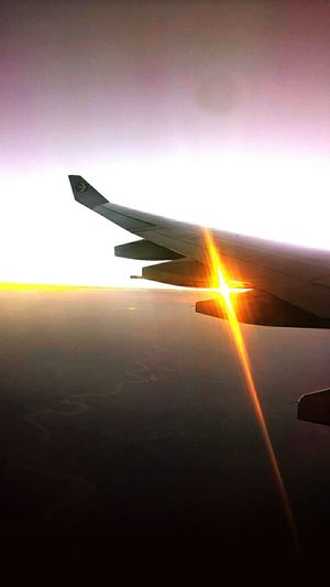Sunset Sun Sunbeam Tranquil Scene Aircraft Wing Airplane Sunlight Transportation Flying Aerial View Lens Flare Horizon Over Water Bird's View September 2016 Showcase September How Is The Weather Today Autumn 2016 Autumn🍁🍁🍁 Outdoors Fly High