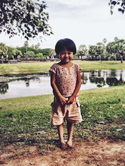 Memories of Angkor, Cambodia, 2005 Front View Childhood Person Smiling Water Elementary Age Standing Child Smile Barefoot Snap A Stranger Mud ASIA Asian Child Field Day Green Color Nature Innocence Outdoors Cute Cute Little Girl Angkor Wat Cambodia Portrait