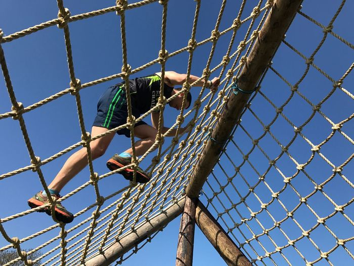 Obstacle Course mud race, obstacle course running. Mud Run Obstaclerun Obstacleracing Obstaclecourse Obstacle Course Obstaclecourseracing Low Angle View Full Length One Person Day Sky Leisure Activity Fence