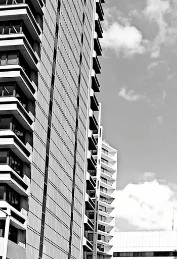 Architecture Built Structure Low Angle View Building Exterior Sky Cloud - Sky City Cloud Outdoors Cloudy Tall - High Office Building Architectural Feature Tall Modern No People Capital Cities