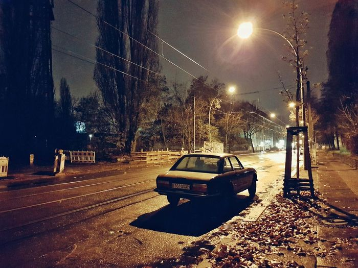 Cars on street at night