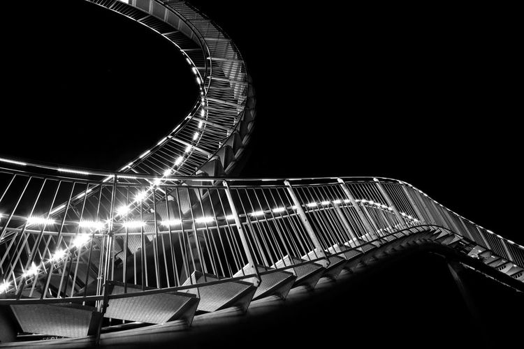 This sculpture Tiger and Turtle - Magic Mountain, by German artists Heike Mutter and Ulrich Genth, is modelled on a roller coaster. Visitors are able to walk the steps. Abstract Abstract Photography Architecture Decision Decisions Illuminated Night No People Rollercoaster Sky Staircase Staircases Steps The Week Of Eyeem Two Ways Up Fujifilm_xseries FUJIFILM X-T2 The Week On Eyem Minimalist Architecture Welcome To Black