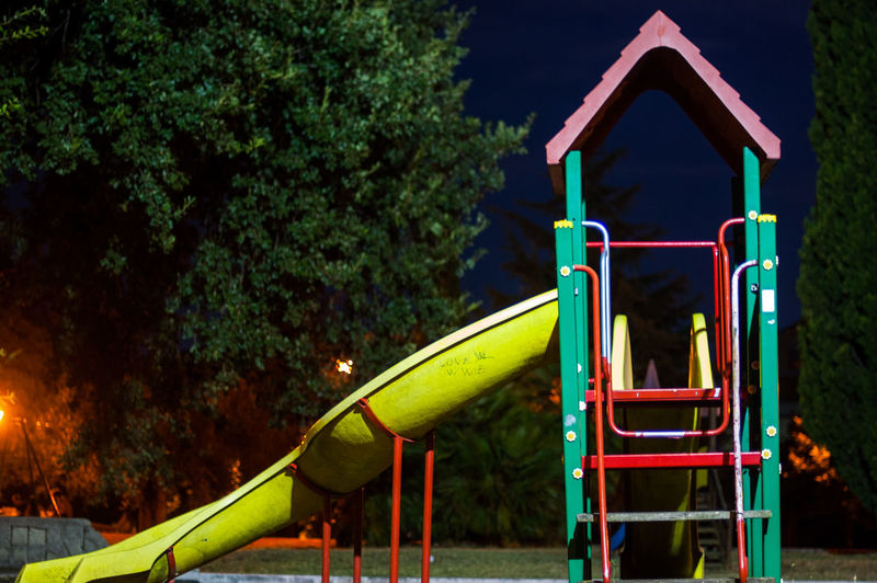 Nightphotography Absence Childhood Empty Focus On Foreground Fun Jungle Gym Ladder Metal Monkey Bars Nature Night Night View Of City Outdoor Play Equipment Outdoors Park Park - Man Made Space Plant Playground Slide Slide - Play Equipment Stage Tree