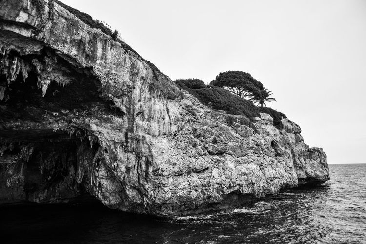 Black & White Beauty In Nature Black And White Cliff Day Eroded Land Monchrome Nature No People Outdoors Rock Rock - Object Rock Formation Scenics - Nature Sea Seascape Sky Solid Stack Rock Tranquil Scene Tranquility Water