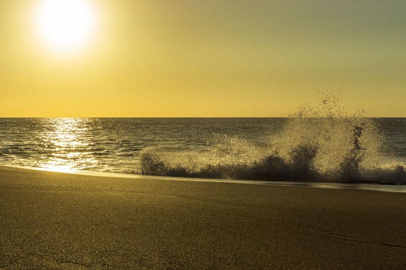Sunset Beach, Pūpūkea, Hawaii, USA Hawaii Beach Beauty In Nature Clear Sky Day Direct Light Horizon Over Water Nature No People Outdoors Power In Nature Sand Sand & Sea Scenics Sea Sky Sunlight Sunset Water Wave Yellow