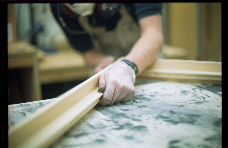 sanding frames Depth Of Field EyeEm Best Shots Film Film Is Not Dead Film Photography Filmcamera Filmisnotdead Filmphotography Focus On Foreground Hand Indoors  Job Man Nikkormat FS (1965) Person Selective Focus Showcase March Taking Photos Taking Pictures Wood - Material Work Working