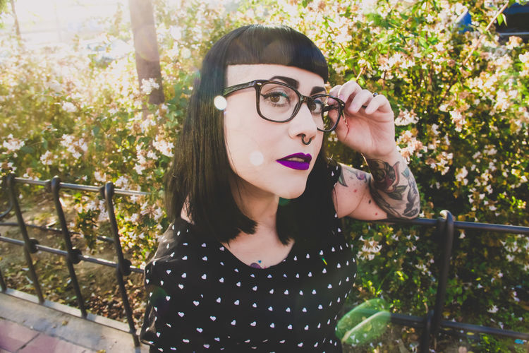Glasses Eyeglasses  Portrait Real People One Person Leisure Activity Young Adult Lifestyles Plant Front View Young Women Casual Clothing Women Outdoors Hairstyle Beautiful Woman Tattoo Tattooed Goth Parking Spring Springtime Plus Size Model Trendy Tree Headshot Nature Standing Contemplation Teenager