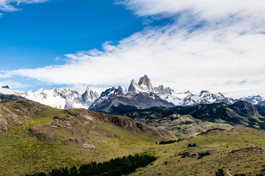 Mt Fitz Roy Argentina Blue Sky Clouds El Chalten Green Hills Mountain Range Patagonia Snowcapped Mountain