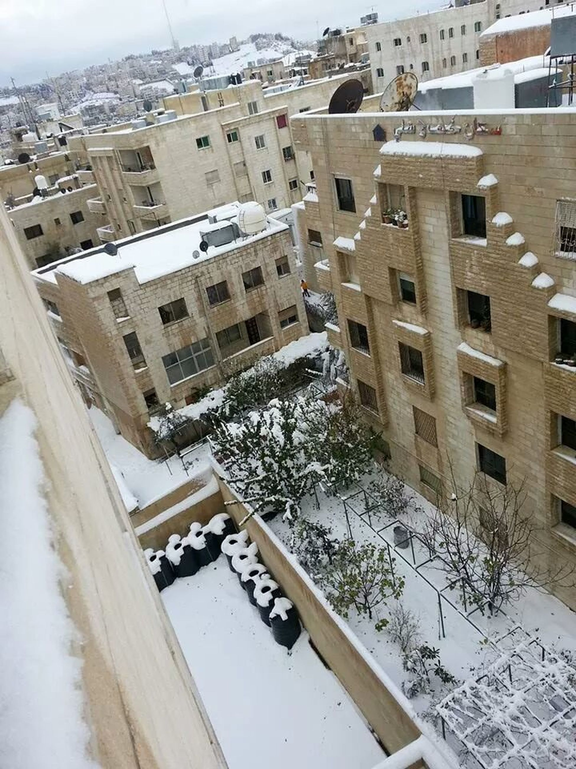 building exterior, architecture, built structure, winter, snow, residential structure, residential building, high angle view, cold temperature, house, city, water, residential district, day, season, tree, outdoors, town, building