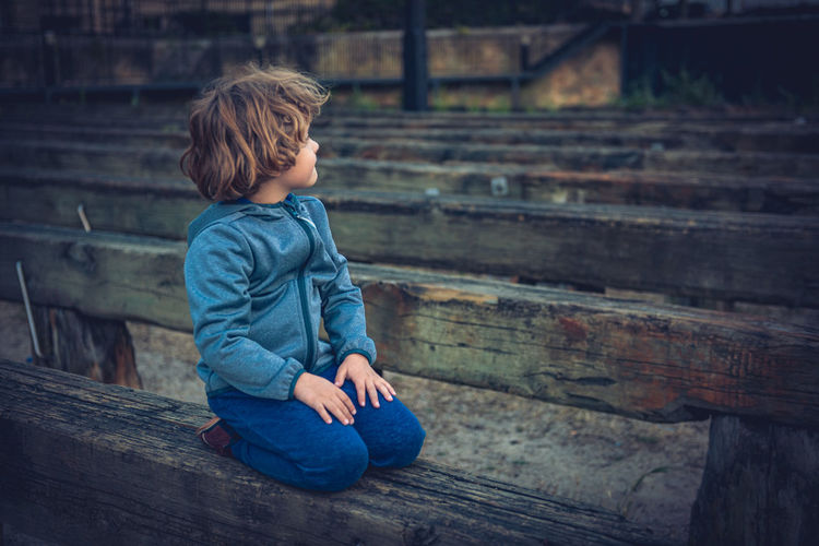 Young boy contemplating sunset in time ramp