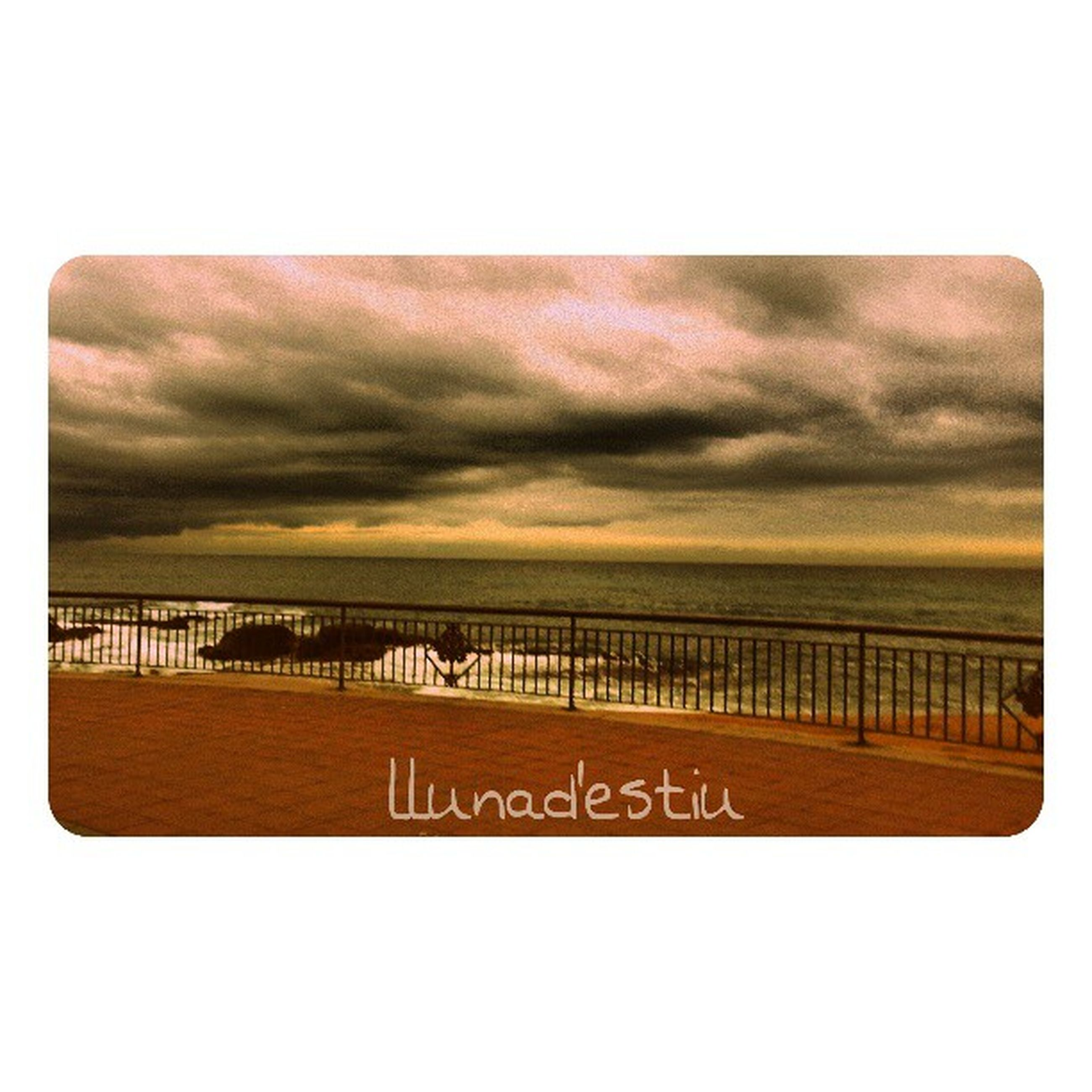 sea, transfer print, sky, water, horizon over water, auto post production filter, cloud - sky, text, tranquility, tranquil scene, beach, western script, scenics, cloudy, pier, nature, railing, communication, cloud, beauty in nature