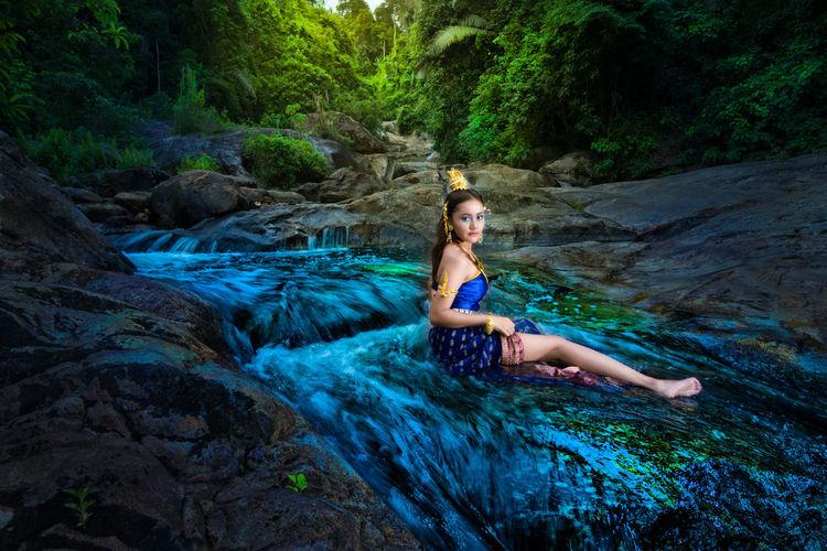 Thai dress fashion at wang mai pag waterfall in thailand.