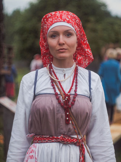 Portrait of woman wearing traditional clothing while standing outdoors