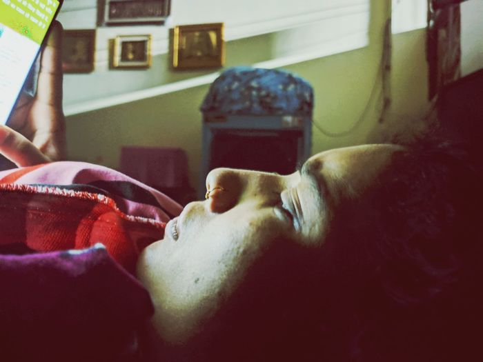 Portrait of man sleeping on bed