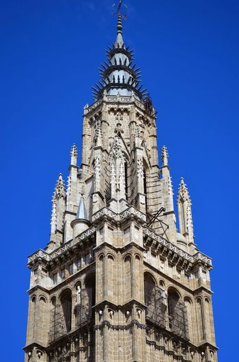 Low Angle View Of Toledo Cathedral Against Clear Blue Sky In City