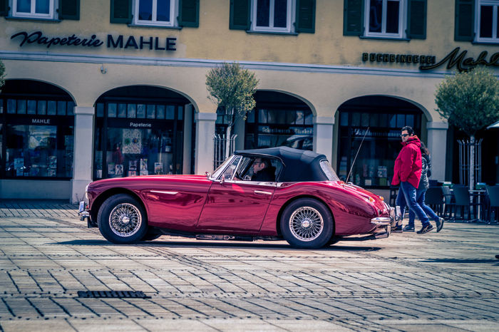 Ludwigsburg, Germany - April 23, 2017: Austin Healey oldtimer car at the eMotionen event on April 23, 2017 in Ludwigsburg, Germany. Austin Austin Healey Automobile Ludwigsburg Red Retro Auto Car City Day Editorial  Healey Land Vehicle Luxury Old Oldtimer Outdoors People Real People Transportation Vintage