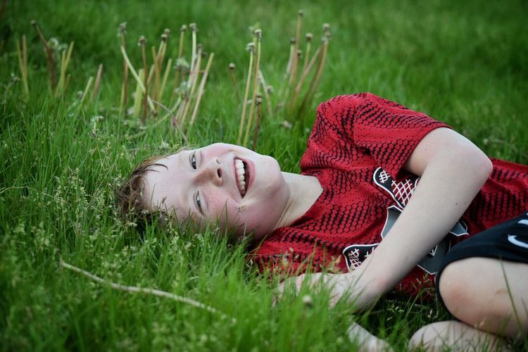 Grass Lying Down Meadow Eyes Closed  Lying On Back Relaxation Outdoors One Person Day Leisure Activity Field Nature Tranquility Summer Young Women Happiness Vacations Real People Smiling Young Adult The Great Outdoors - 2017 EyeEm Awards The Portraitist - 2017 EyeEm Awards Children Youth Of Today One Boy Only