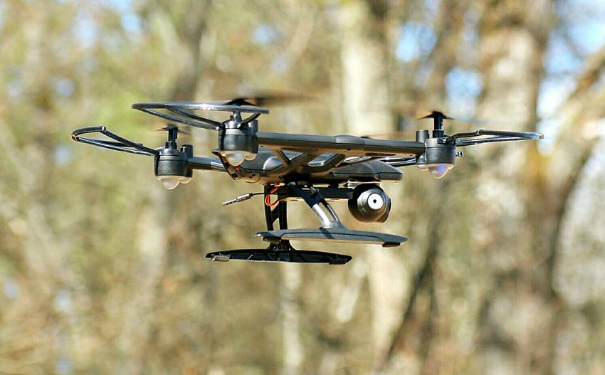 Close-up of quadcopter against blurred background
