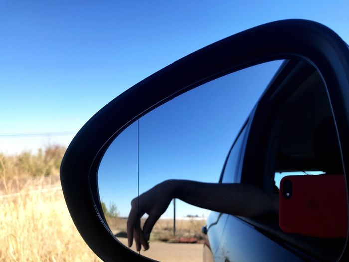 Looking back Elliot Erwitt Thinking Side-view Mirror Car Day Clear Sky Blue Sky
