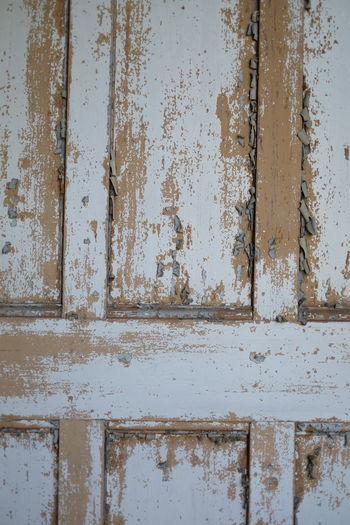 Full Frame Shot Of Weathered Wooden Door In Abandoned House
