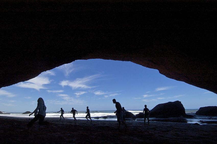 The beach in Mirleft, Morocco. Morocco MoroccoTrip Natural Arch Silhouette Arch Beach Beauty In Nature Leisure Activity Lifestyles Mirleft Real People Scenics Sea Silhouette Soccer Stone Arch Togetherness Water