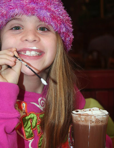 Portrait Of Happy Girl With Hot Chocolate Drink
