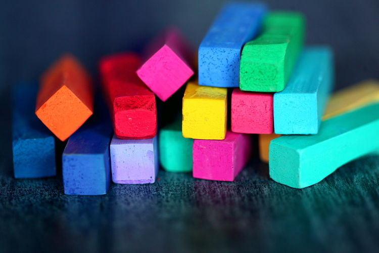 Art And Craft Creativity Pastels Rainbow Colors Block Chalk Choice Close-up Crayon Cube Shape Large Group Of Objects Multi Colored No People School Selective Focus Shape Still Life Table Toy Variation