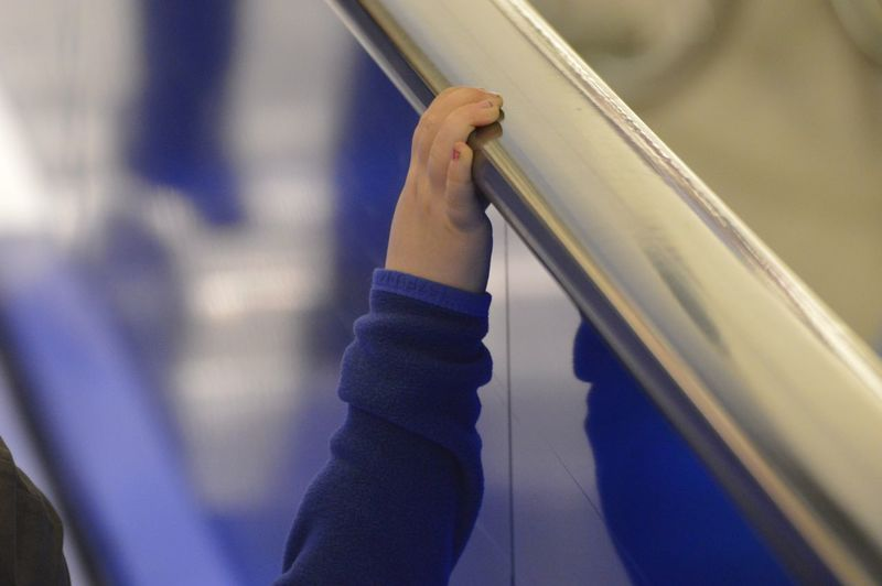 Cropped Hand Of Baby Holding Railing