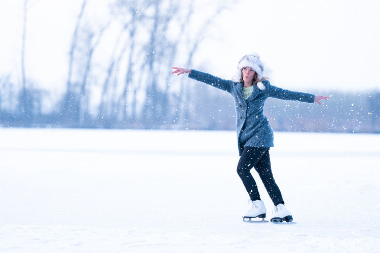 Full length of woman walking on snow