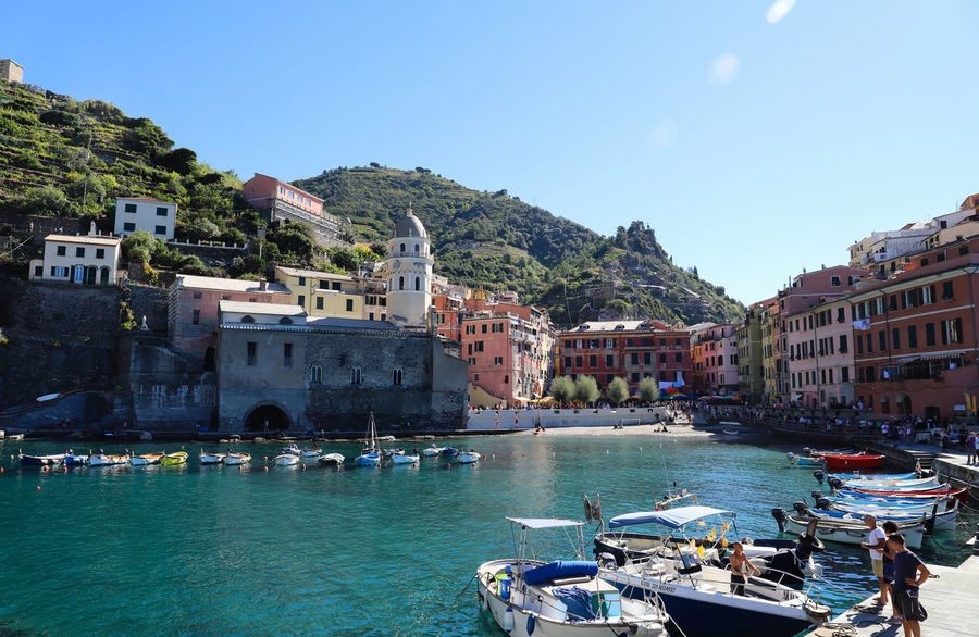 Cinque Terre Harbour Architecture Building Building Exterior Built Structure Canal City Colorful Day Incidental People Italy Mode Of Transportation Mountain Nature Nautical Vessel Outdoors Passenger Craft Residential District Sea Sky Sunlight Transportation Vernazza Village Water Waterfront