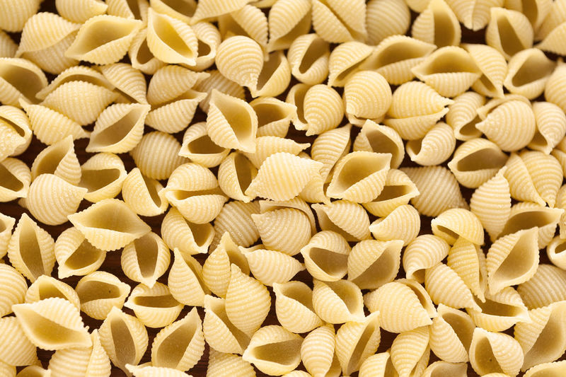 Egg Conchiglie pasta background Dry Pasta Backgrounds Background Egg Conchiglie Conchiglie Conchiglie Pasta Egg Pasta Full Frame Italian Pasta Natural Light Background Close Up Dry Pasta Italian Food No People Pasta Studio Photography Food And Drink Food Large Group Of Objects Close-up