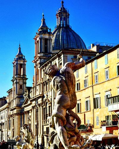 Piazza Navona Sculpture City Travel Destinations Statue No People Building Exterior Outdoors Animal Themes Architecture Cityscape Sky Clock Tower Day Roma Rome Monument Statue Dome Church!  Built Structure Architecture Cloud - Sky Cityscape Stone House PiazzaNavona