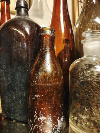 Bottle Refreshment Food And Drink Indoors  No People Close-up Freshness Drink Cold Temperature Day Glass Bottle Antique Bobbles &trinkets Glasses Light And Shadow Shiny Indoors  Textures And Surfaces Brown