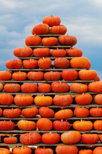 Full frame shot of orange stack against sky