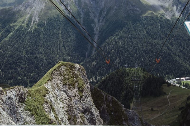 High Angle View Of Cables Against Mountains