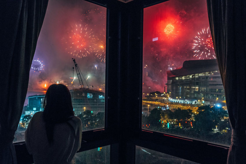 Adults Only City Fireworks Display Adult Woman Firework Illuminated Lights And Shadows Looking Through Window Night Sillouette Single Woman Sky Window