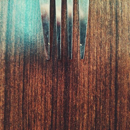 High angle view of fork on wooden table