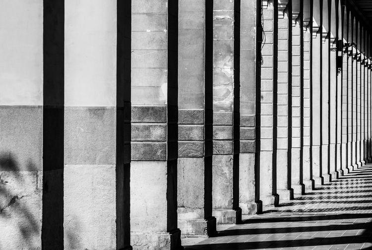 Shadow of columns on corridor