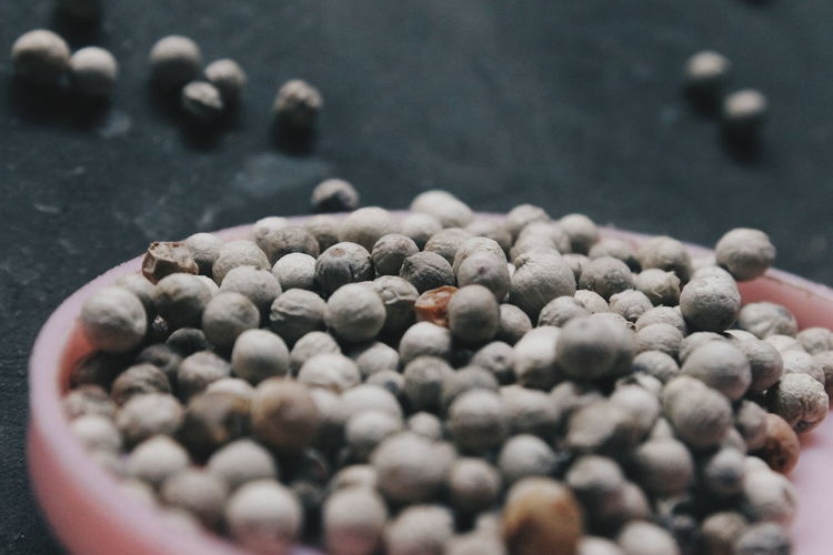 Close-up of peppercorns in bowl
